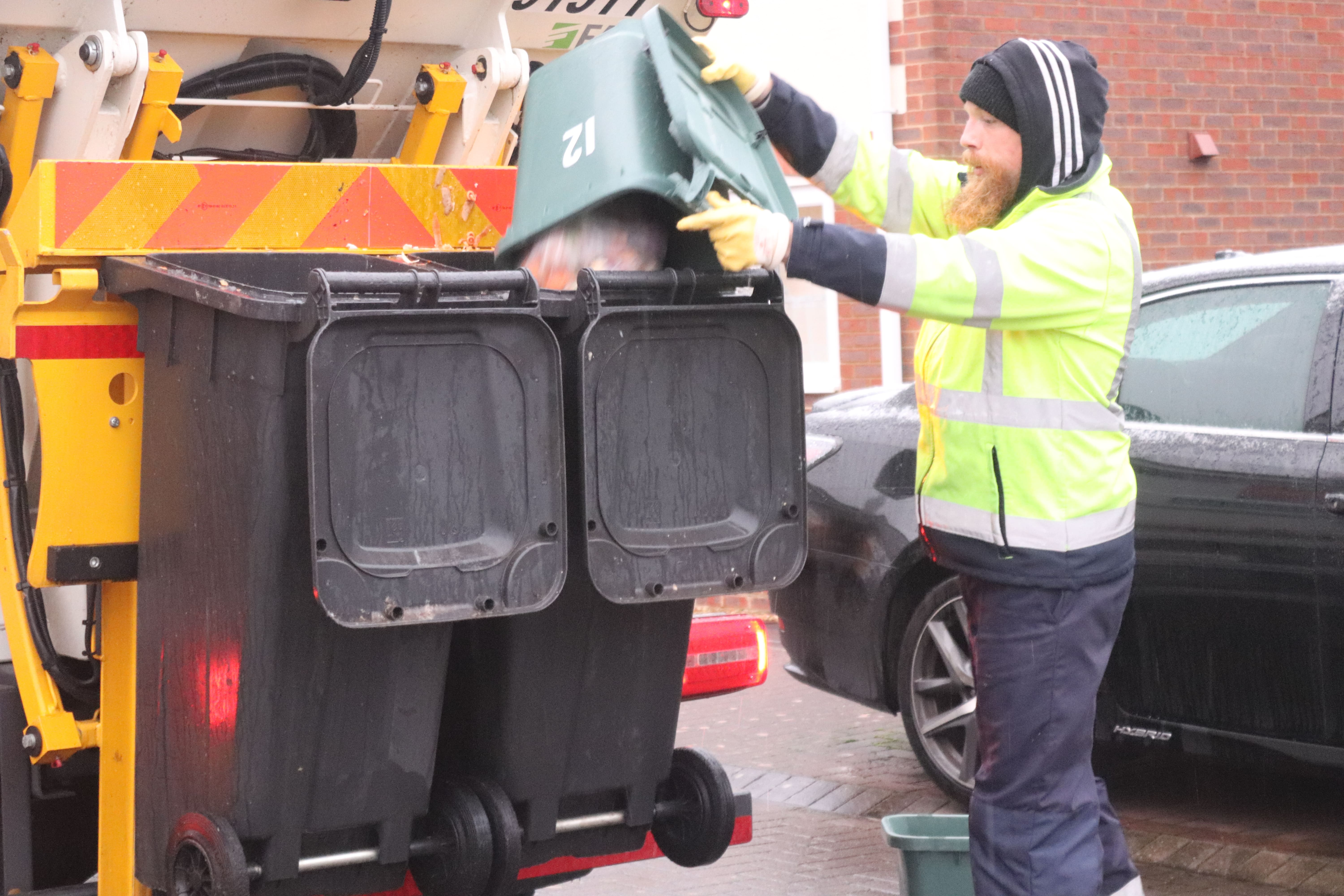 Picture of food waste being emptied into the collection vehicle