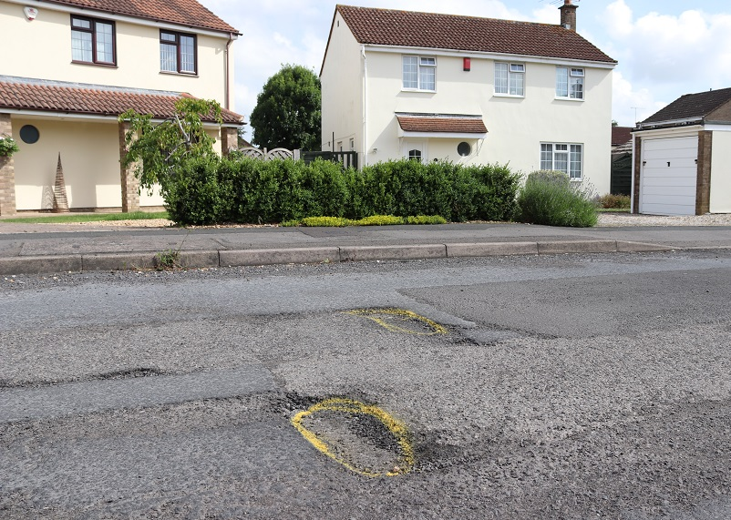 Photograph of a pothole on residential street