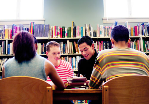 Young adults in a school library