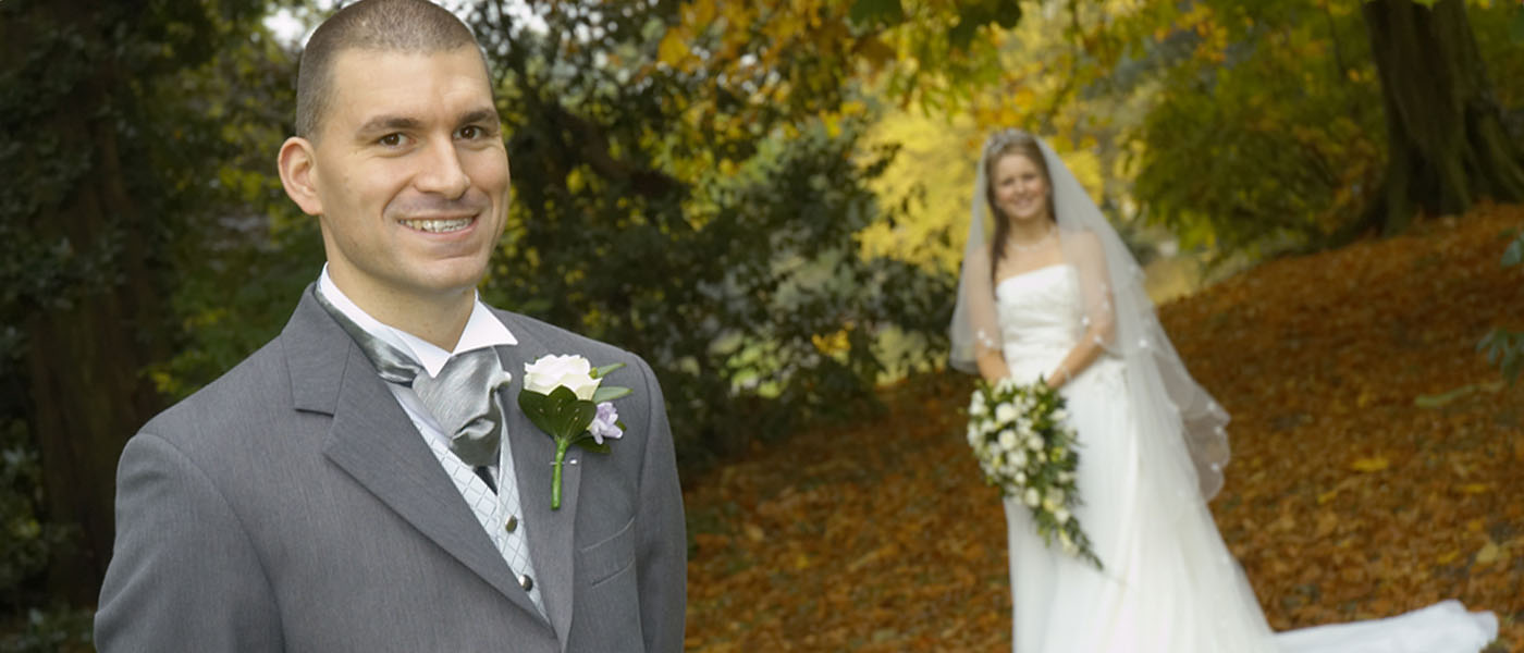 Bride and groom in green space outside Swindon Register Office
